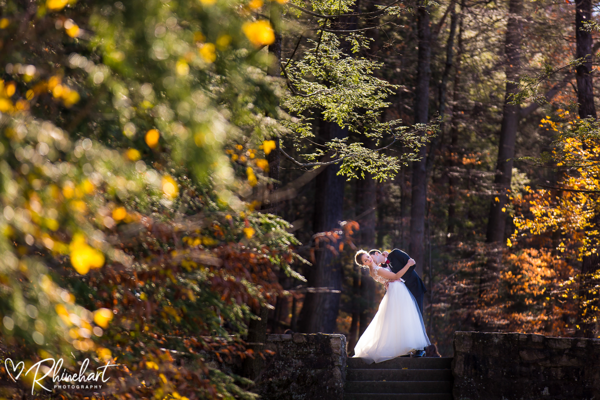 Omni bedford springs wedding grotto in autumn with bride and groom dipping