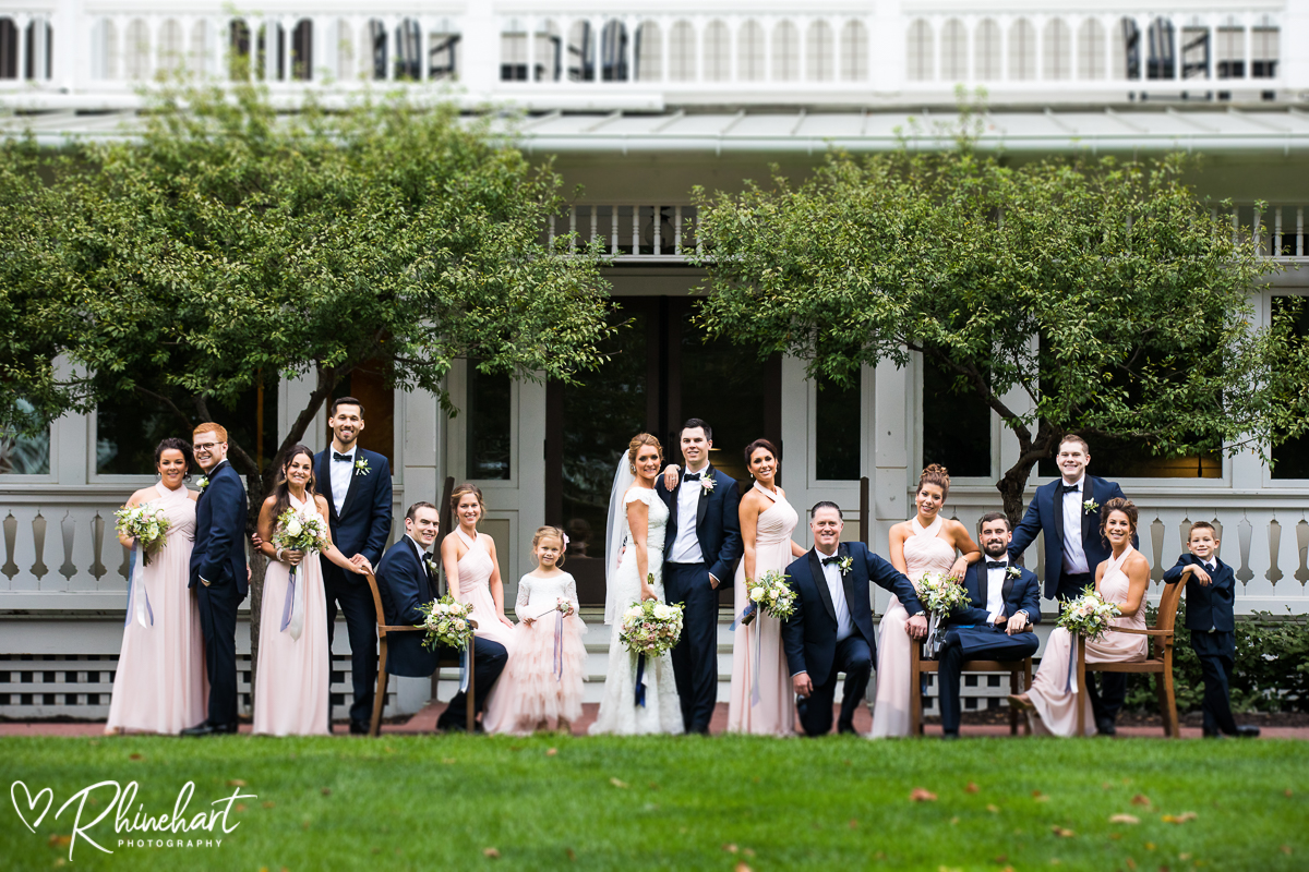 summer bridal party poses in front of the omni bedford springs resort in pennsylvania