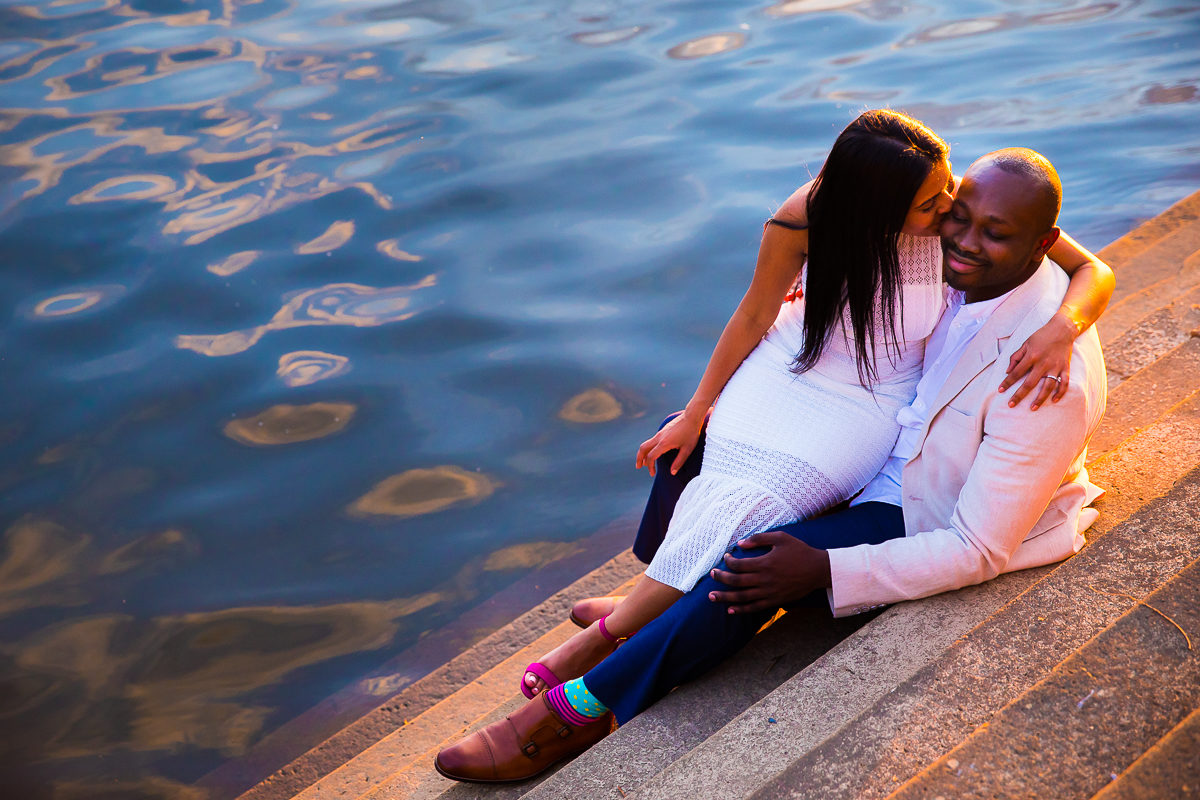 couple embraces during their colorful creative wedding engagement session in Harrisburg on front street