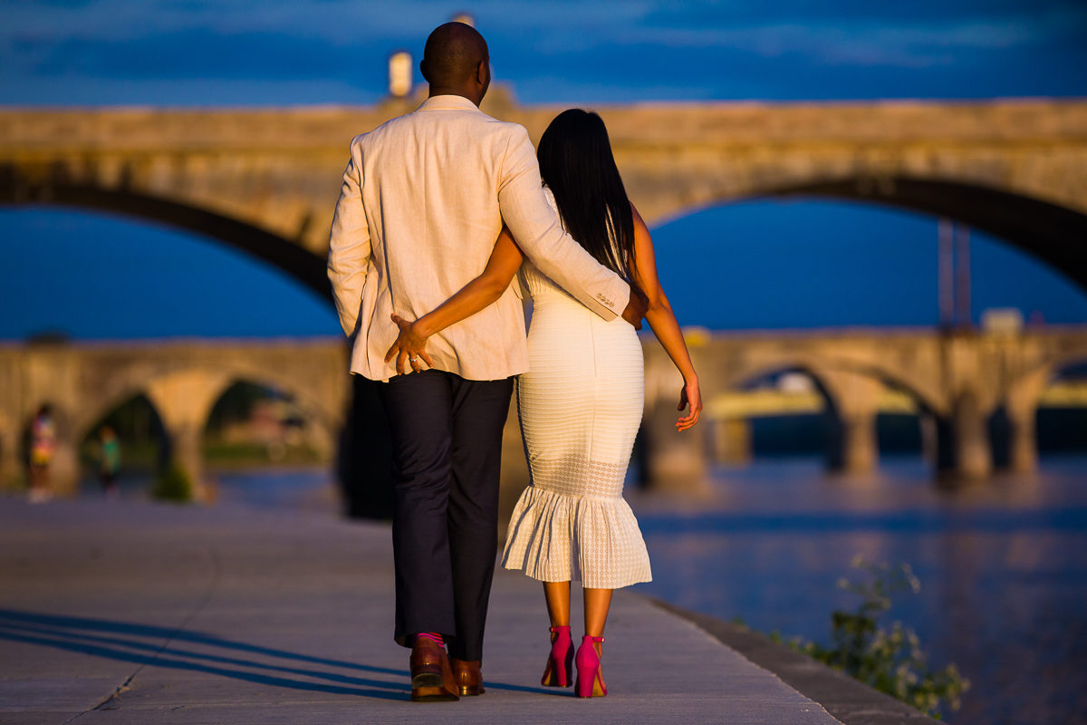 cute engaged couple strolls along the susquehenna in white for their engagement photography session