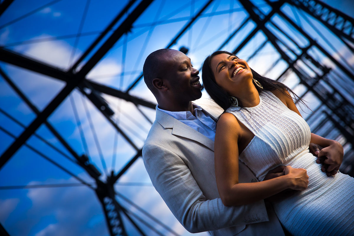 blue sky and happy couple laughs on the walnut street bridge engagement photos in Harrisburg creative best