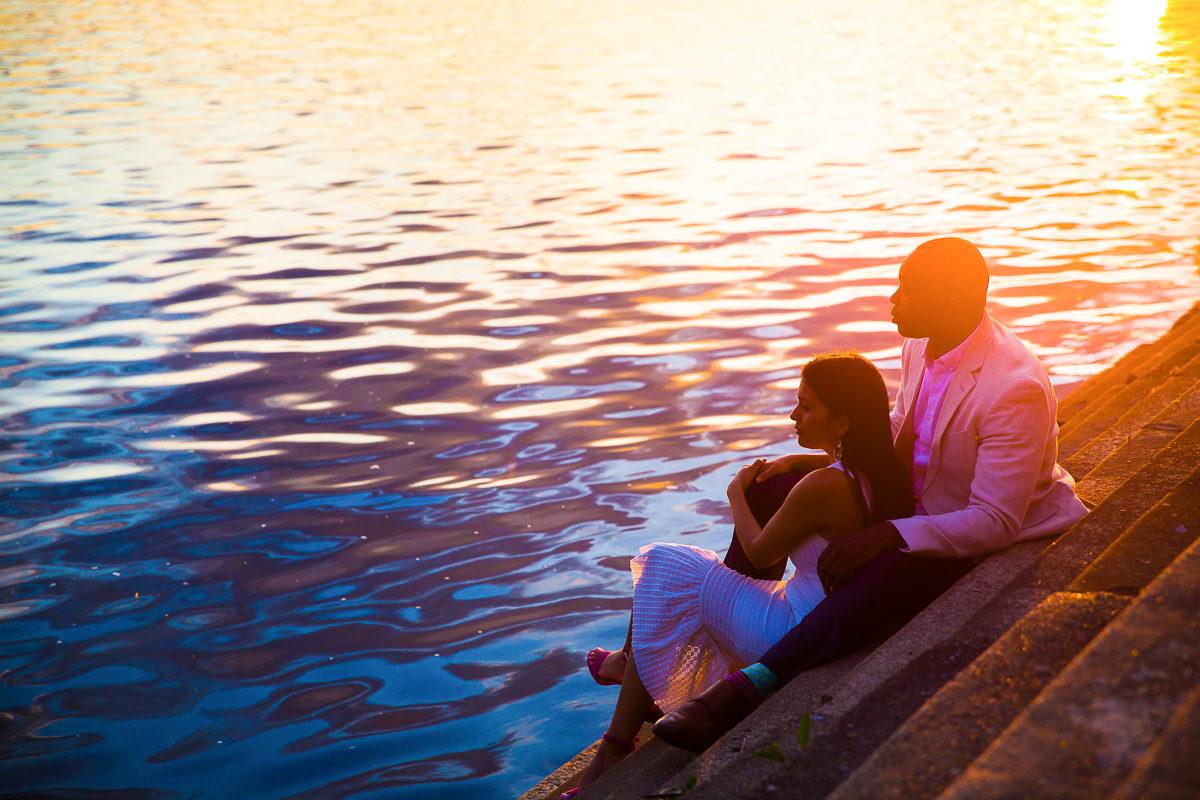couple views the Susquehanna river during their Harrisburg engagement