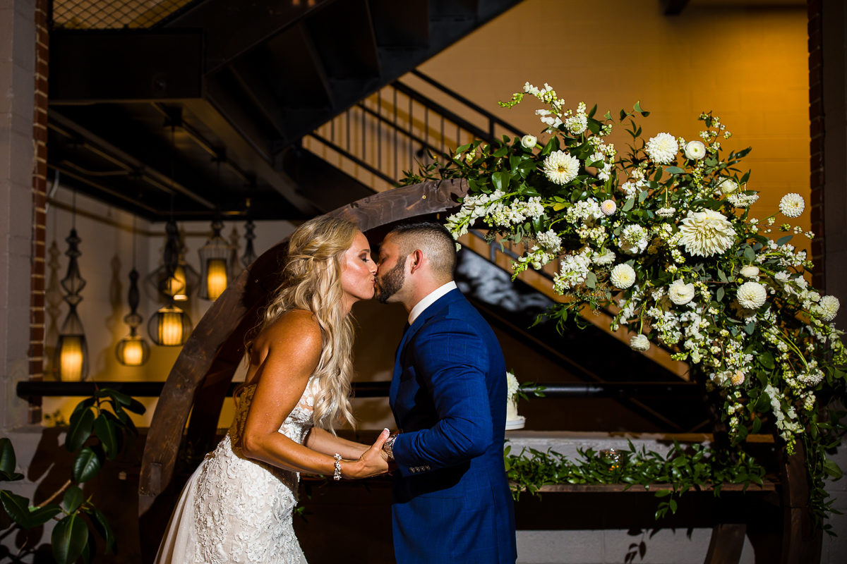 Sealed with a kiss under the staircase and florals at the Grant Street Loft