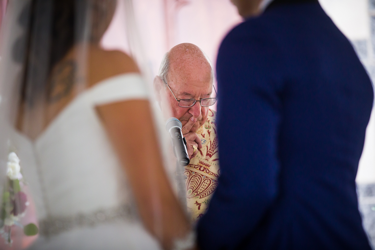 ordained father of the bride speaks during the wedding ceremony at the foundary on 16th st NW in washington dc