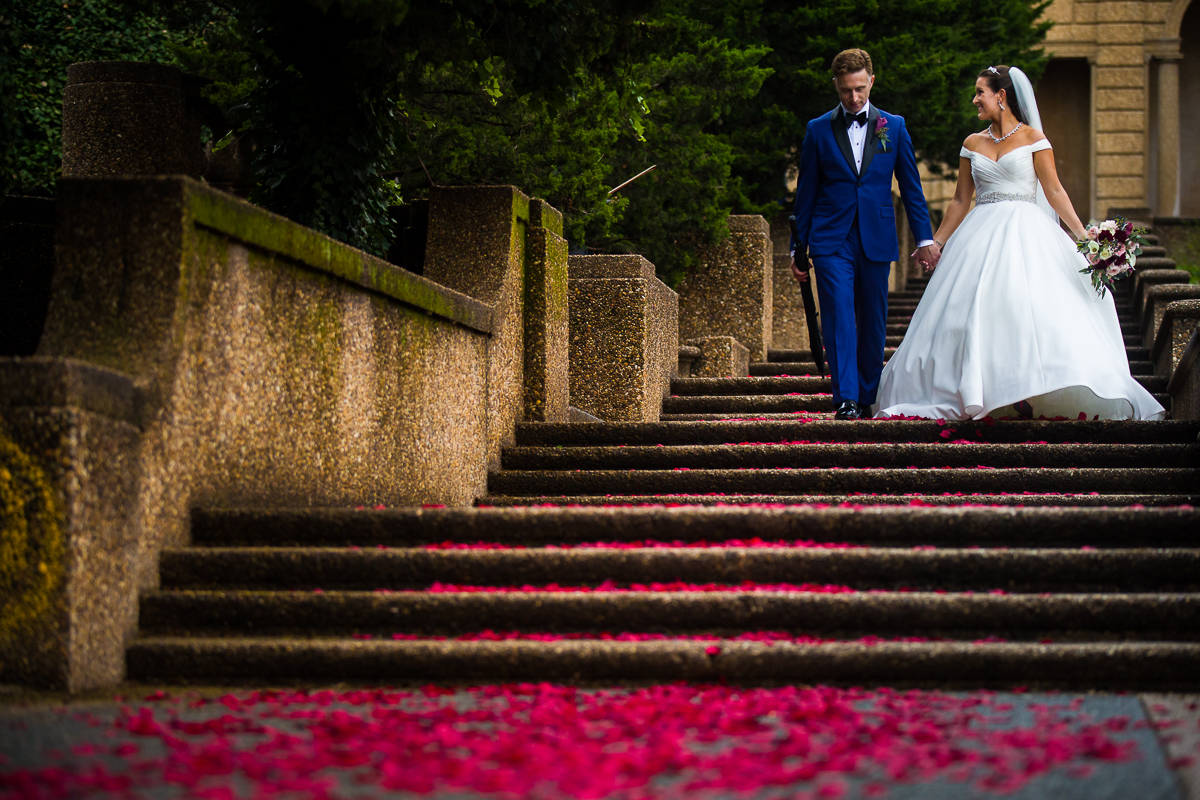 red rose petals lining the meridian hill park in Washington dc for this classic elegant timeless wedding