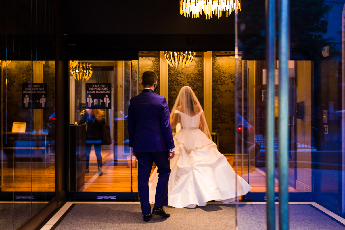 bride and groom entering the darcy hotel for their washington dc wedding reception