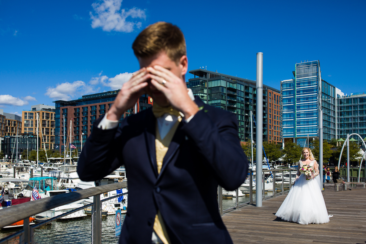 first look photos dc at the wharf marina dock in front of the canopy Hilton