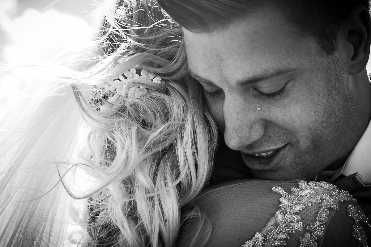 a tear slides down the cheek of a groom during this emotional first look in Washington dc
