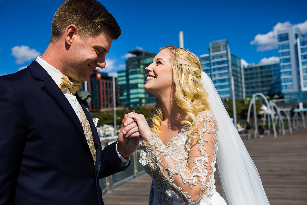 overjoyed couple during Washington dc wedding day first look at the wharf