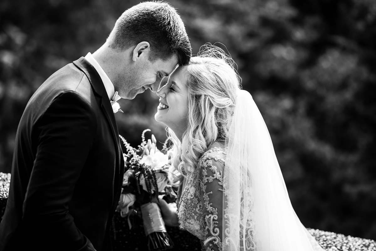 black and white photo of bride and groom on wedding day in meridian hill park in Washington dc