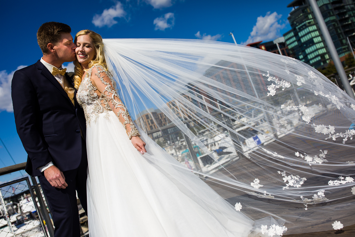 brides veil catches the breeze in this dc wharf wedding at the canopy by hilton