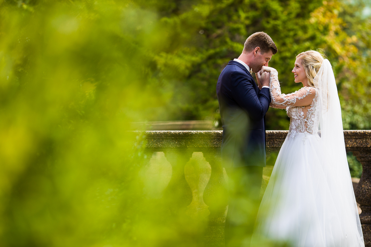 groom kisses brides hands in this intimate meridian hill wedding photography moment