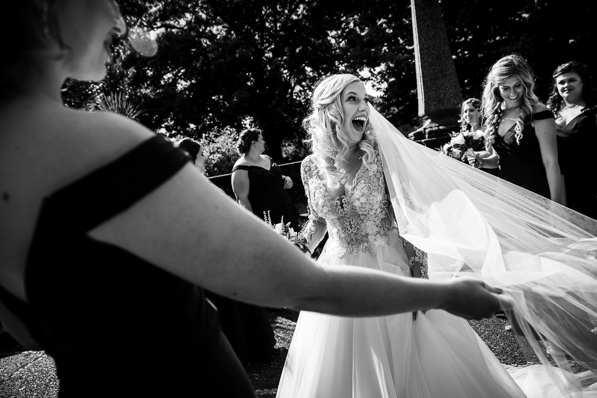dc creative candid moment authentic wedding photographer surprised bride in black and white photograph