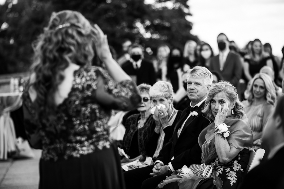 arlington mother wipes a tear during ceremony in black and white image captured by photojournalistic wedding photographer