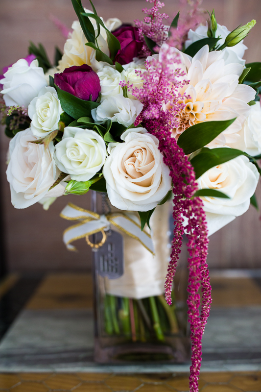 bridal bouquet with memorial tags and rings honoring loved ones who passed