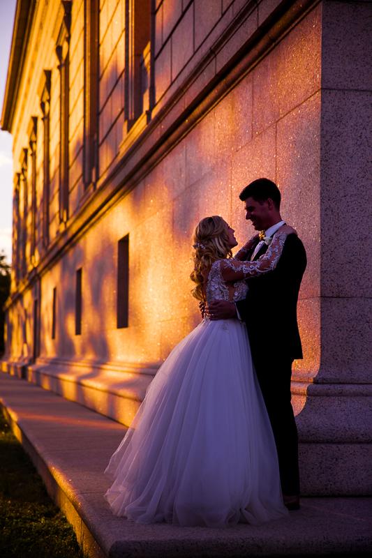 sunset photo of wedding couple at gw memorial in Alexandria Virginia