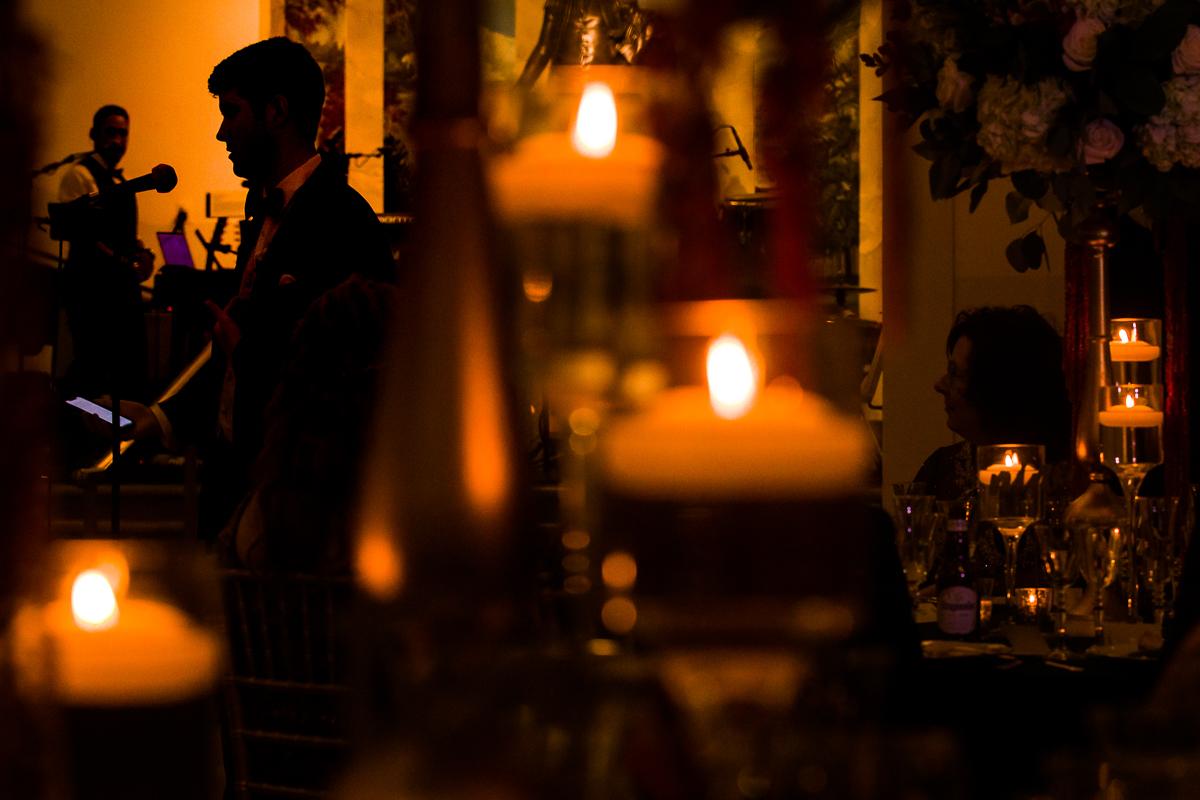 creative artistic dc wedding photographer in Arlington Virginia brings romantic candle-lit speeches in gw ballroom