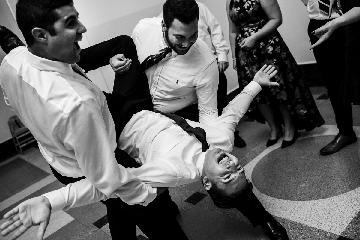 best authentic moments natural wedding photographer in Washington dc groomsmen upside-down in black and white photo