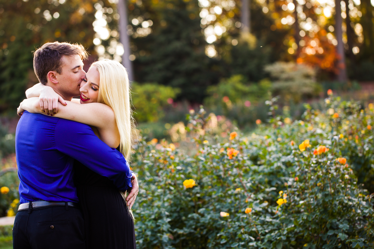 autumn vibes during this magical hershey engagement session with a hugging couple
