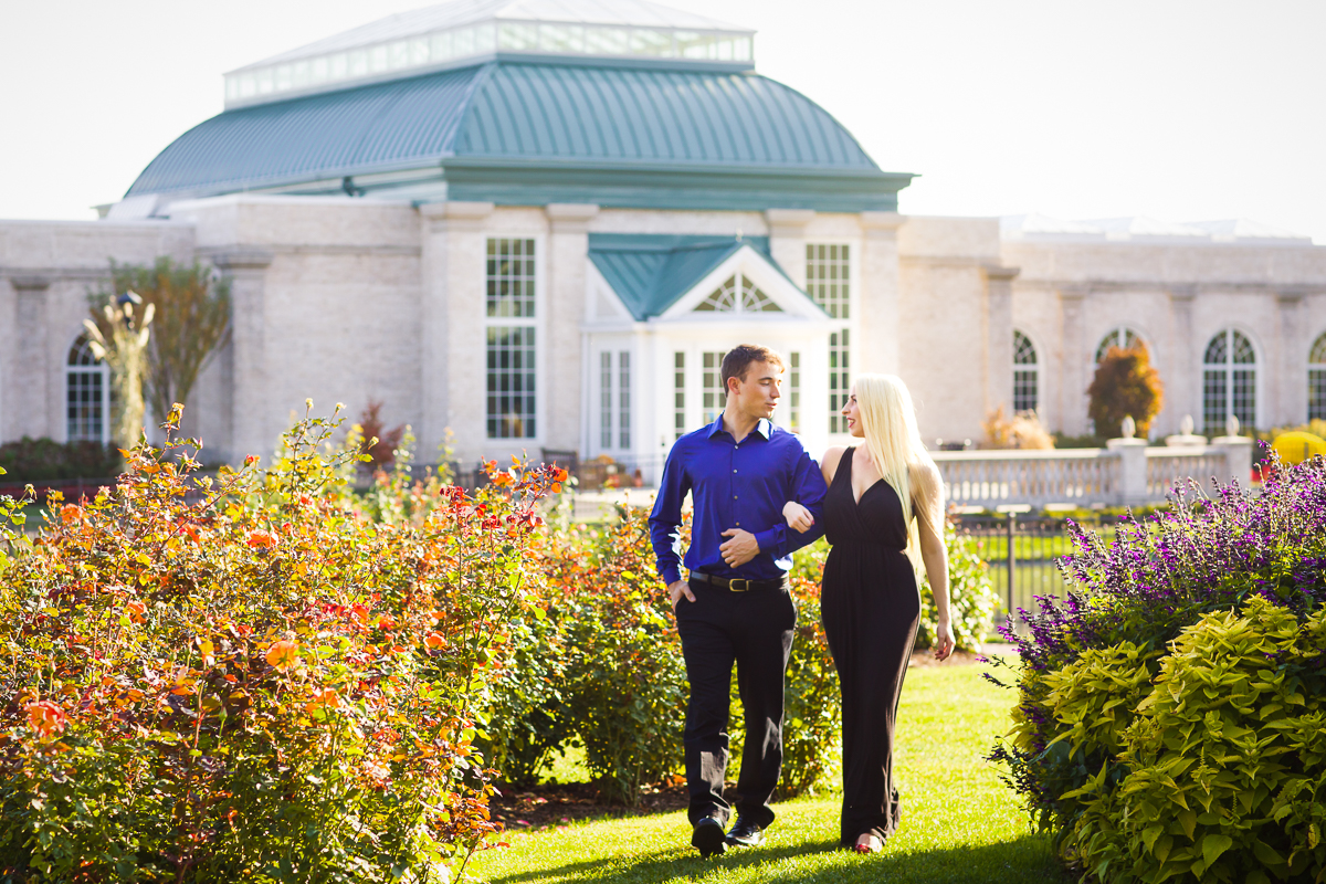 engaged couple strolling together in Hershey gardens for their engagement photos