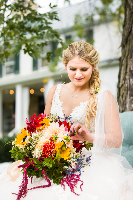 Silverbrook Farm bride holds colorful fall wedding boquet