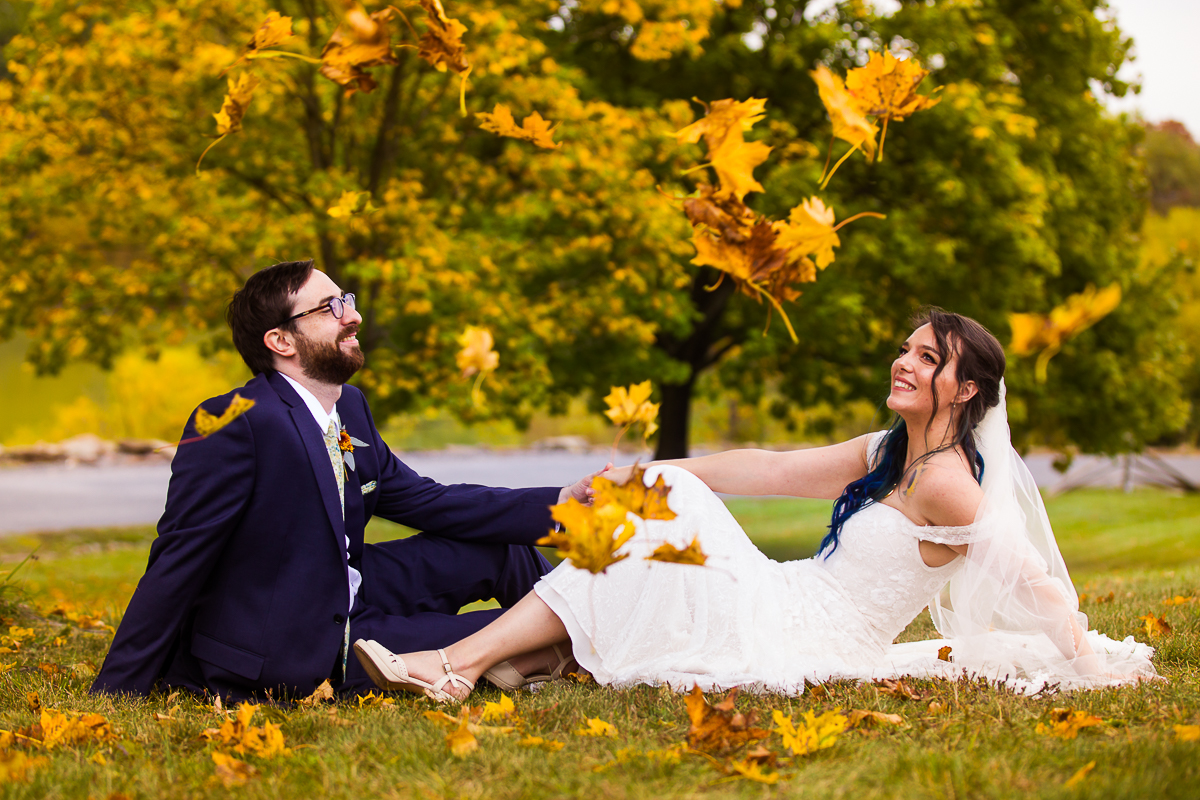 falling leaves at Gettysburg lodges with a wedding couple