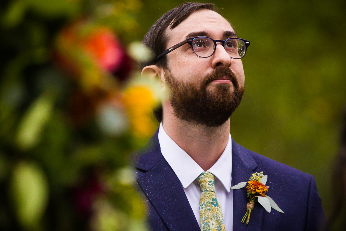 rainy day groom with water droplets on his glasses