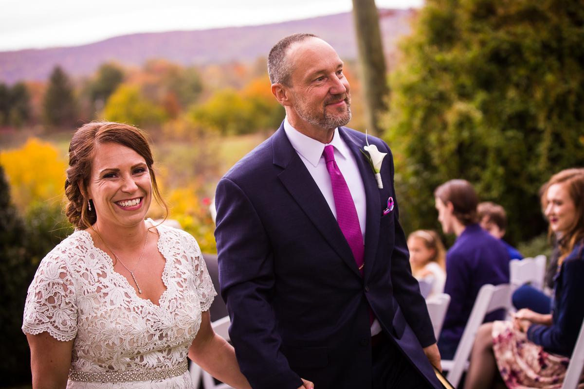 silverbrook-farm-wedding-aisle-smiling-husband-wife