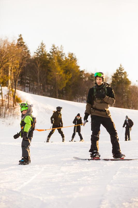 snowboarding dad child blue mountain resort