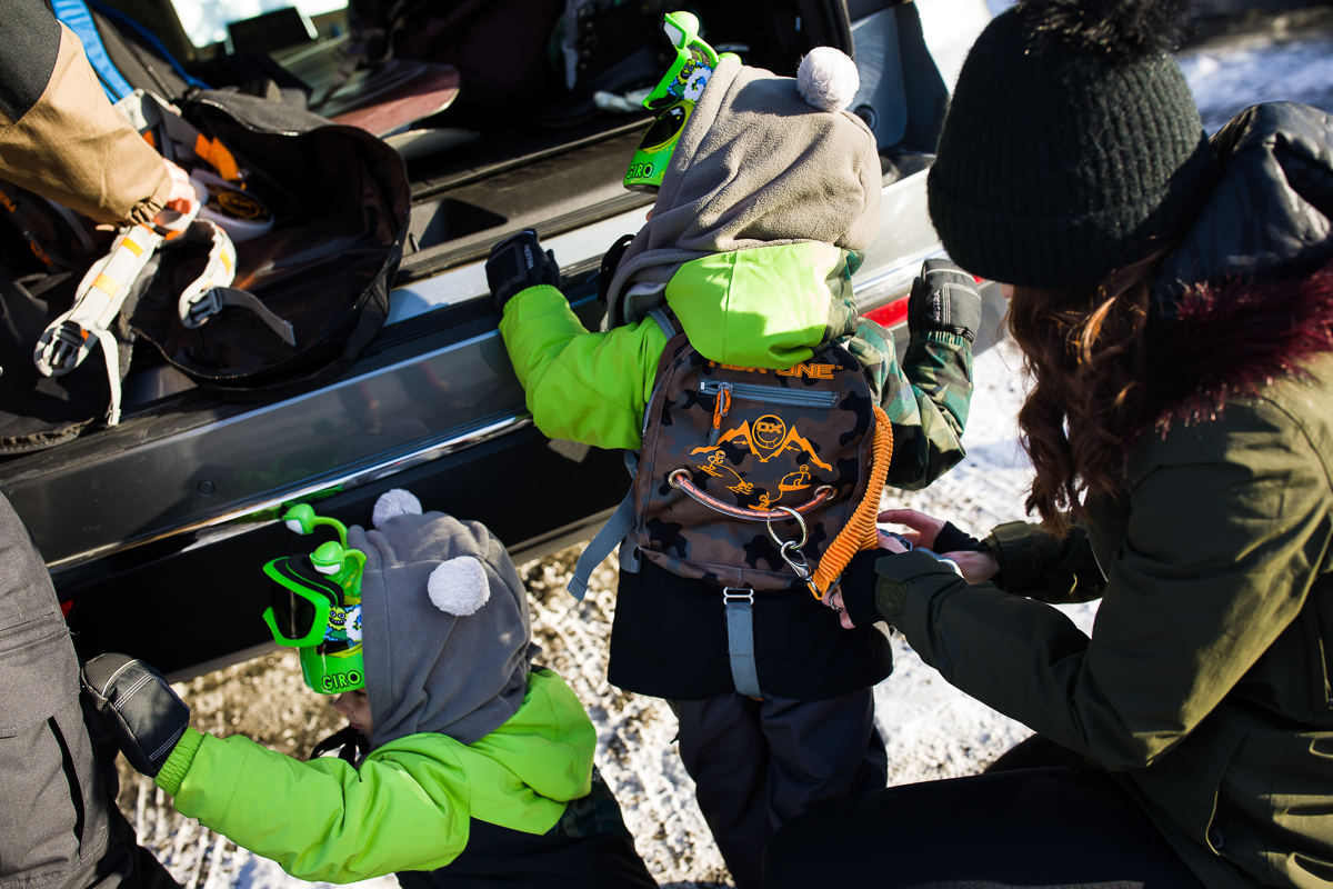 lehigh valley family lifestyle photography showing preschool boys getting ready to snowboard