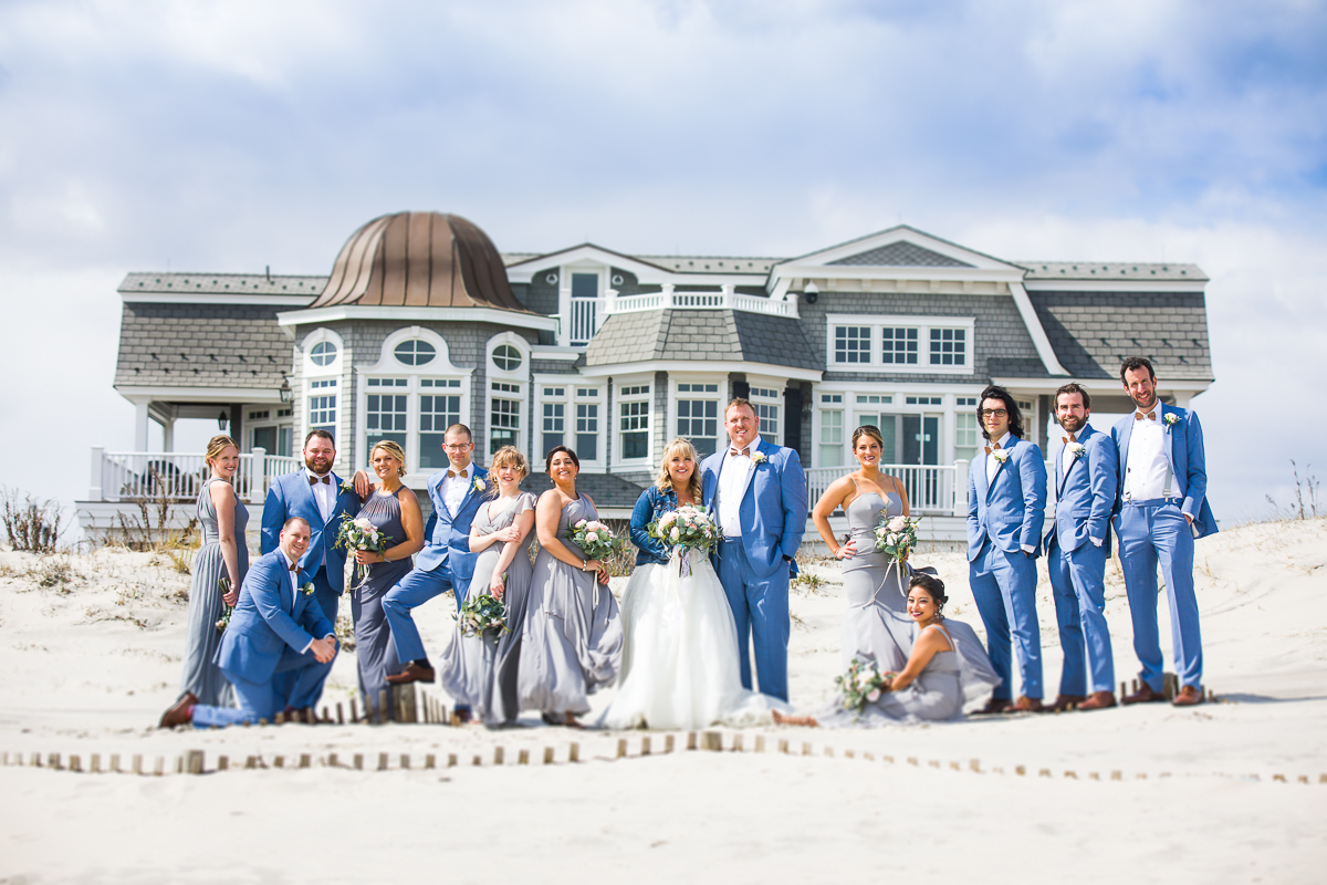the reeds bridal party posed in front of a beach house in stone harbor nj creative best artistic wedding photographers
