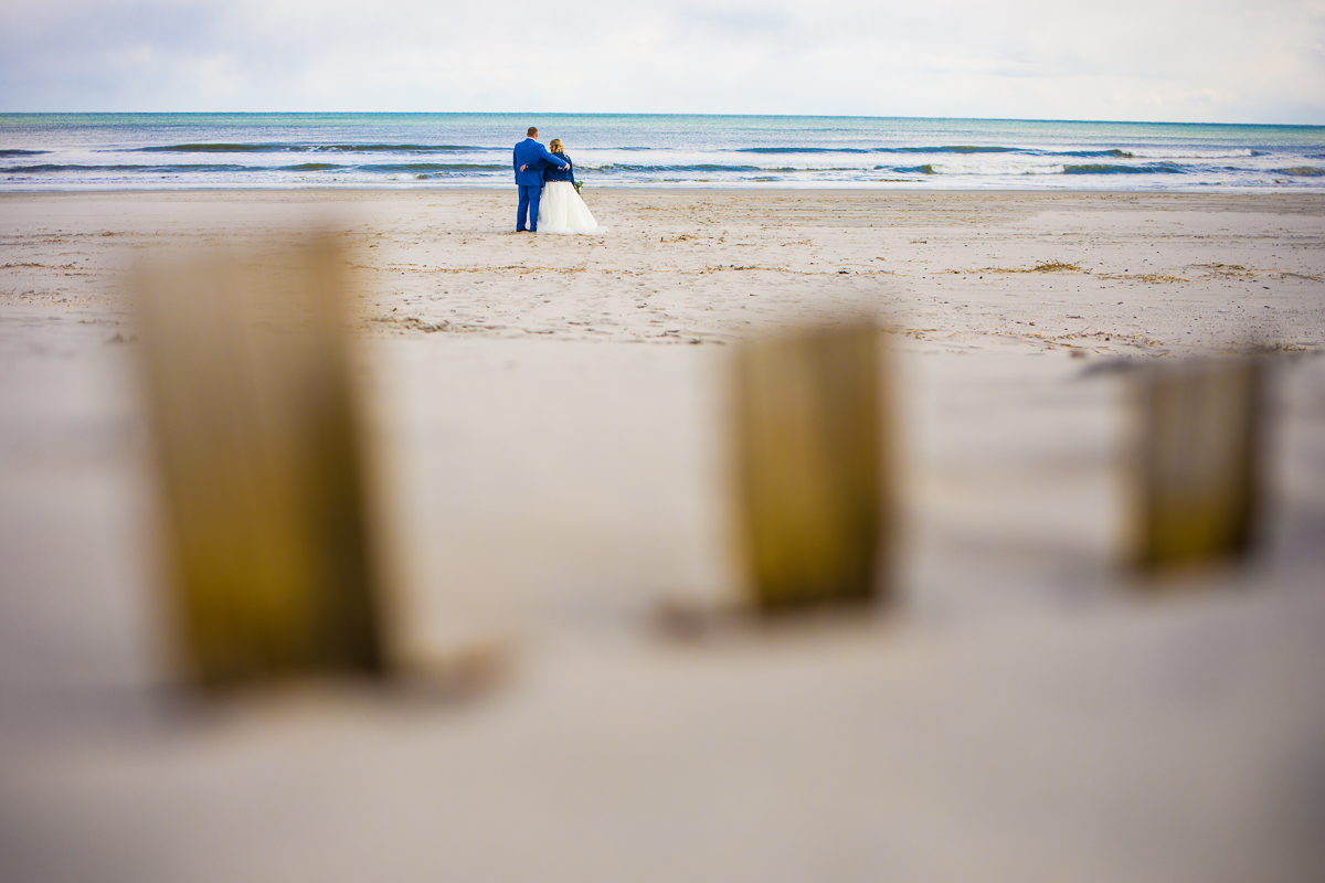 couple looking out on water together-- a view from the sandune, teal blue water in nj
