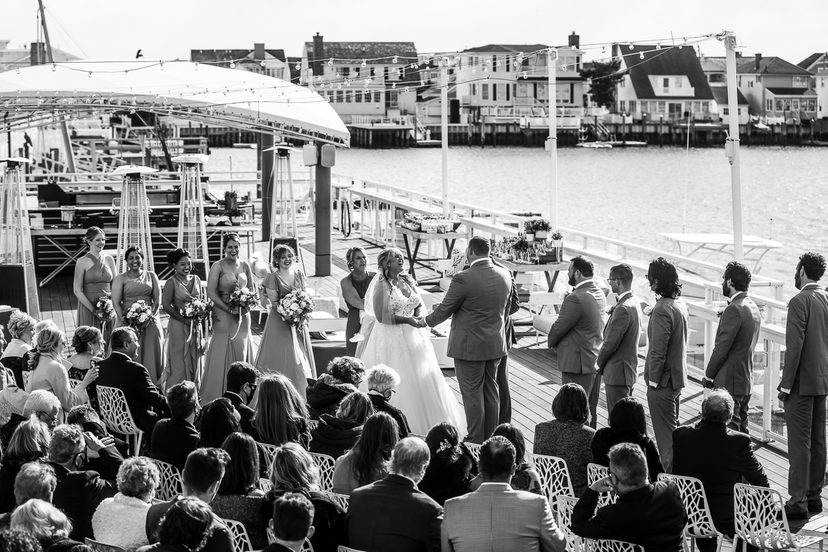 black and white reeds stone harbor wedding photograph of ceremony on the bay side