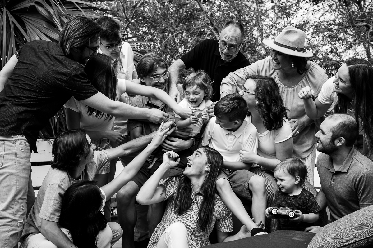 fun creative family portrait photographer moments in black and white laugher