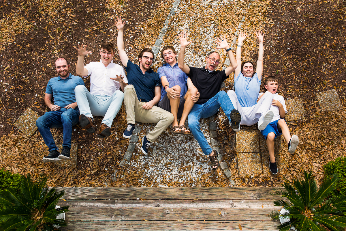 family members jump a forced perspective trick used by award winning family portrait photographer