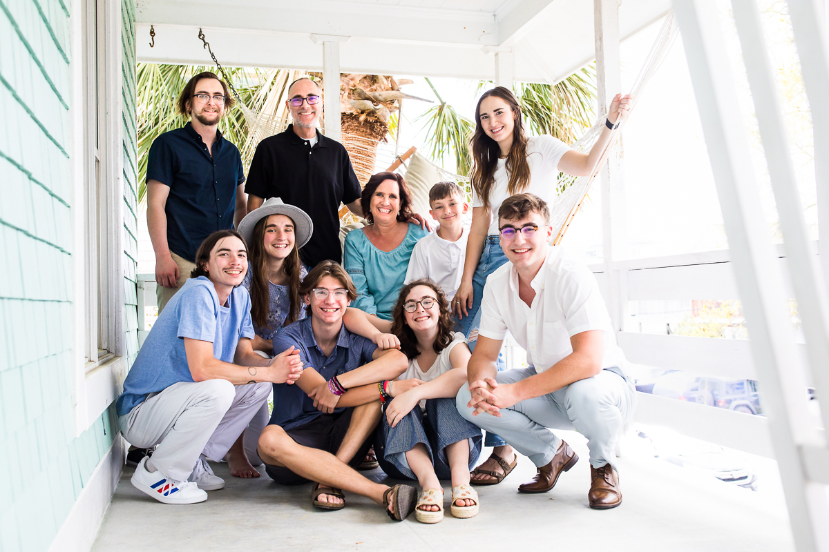 family gathers for portraits on wilmington nc beach house porch