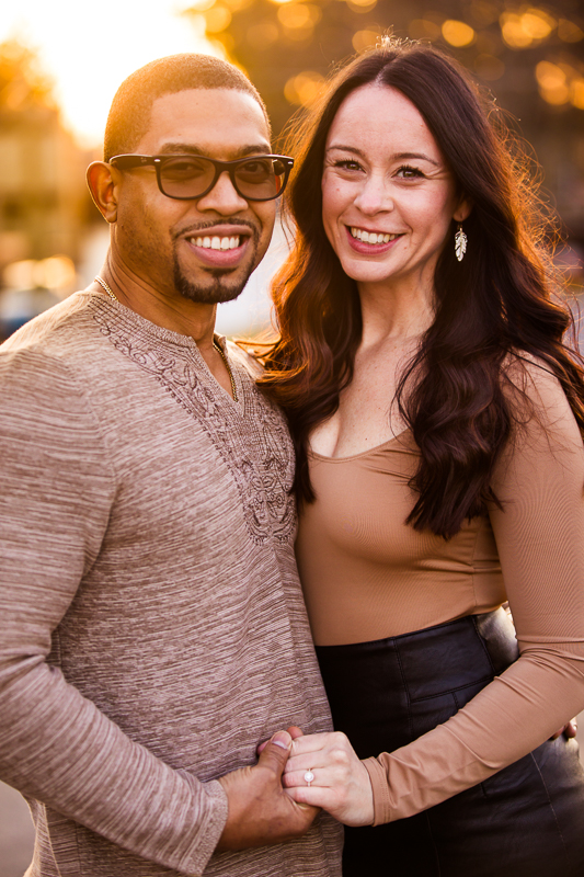 engaged couple smiling together while holding hands golden hour portrait photographer in reading pennsylvania