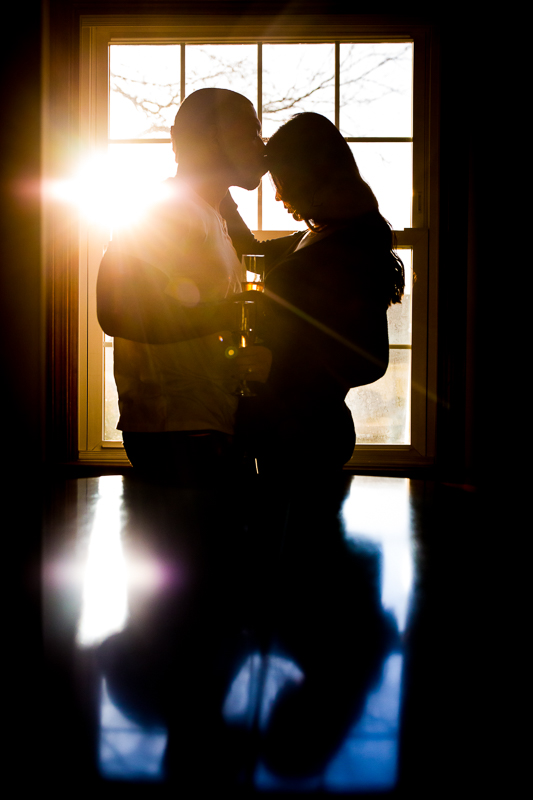 Silhouetted couple in blue and yellow at home engagement photography comfortable natural candid in pennsylvania