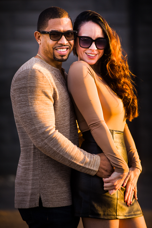 Couple wearing sunglasses and neautral colors captured by unique portrait photographer in reading Pennsylvania