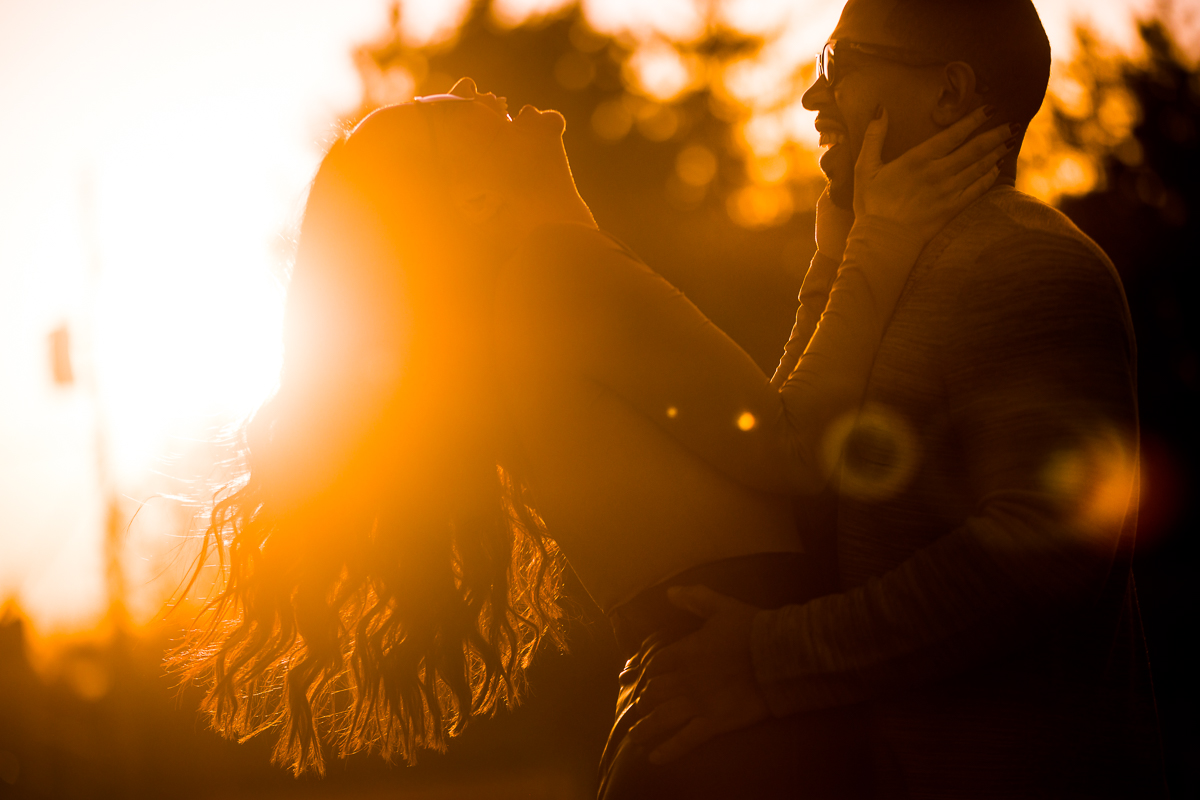 bear creek mountain resort photographer couple laughing in the sunlight with the flare of golden hour in pennsylvania