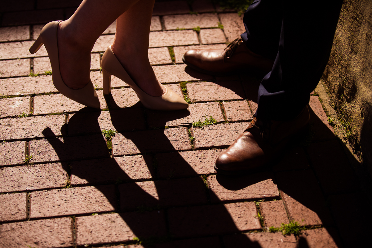 creative shadow photo with tan heels and brown dress shoes