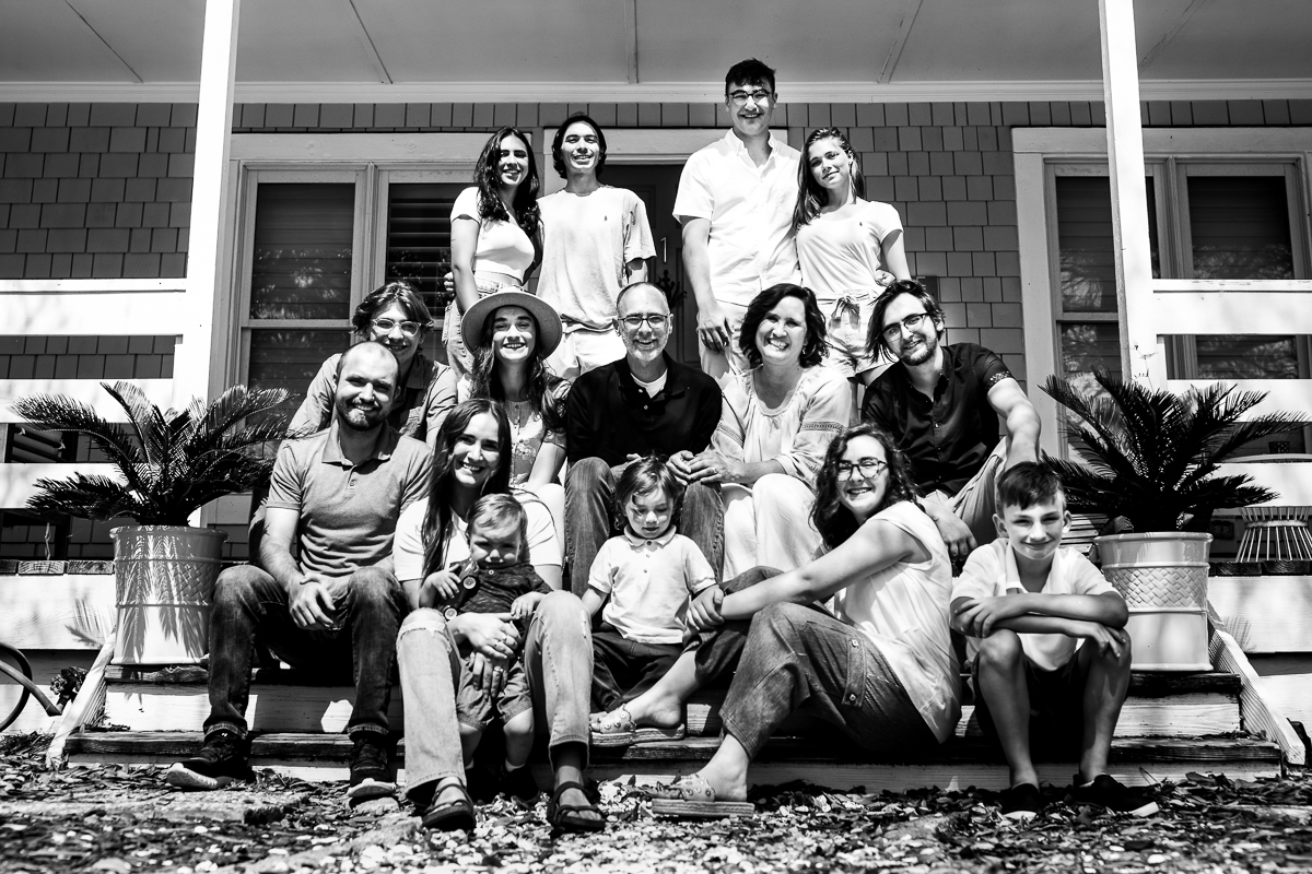 black and white authentic family group portrait taken on vacation in wilmington NC