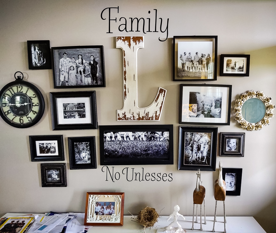 family photo wall display with black and white photos