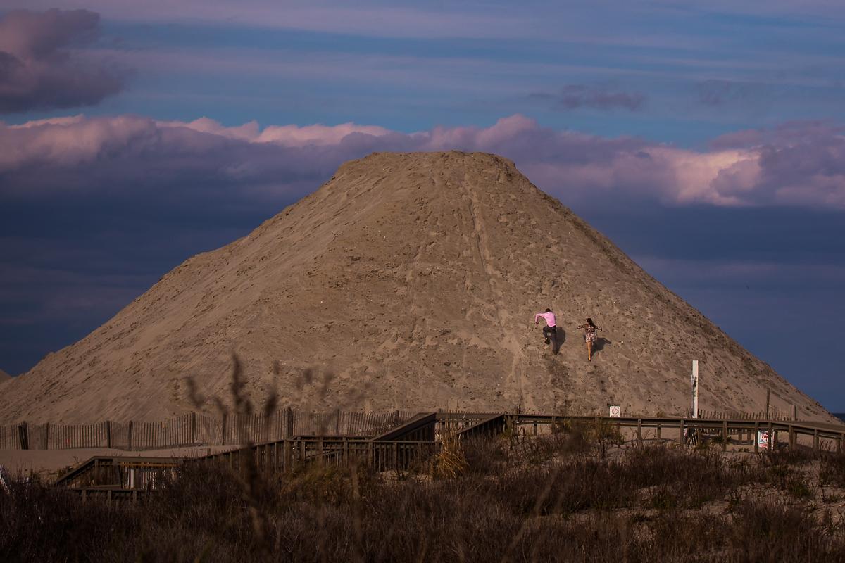 couple-climbing-sand-dune-wildwoods-beach