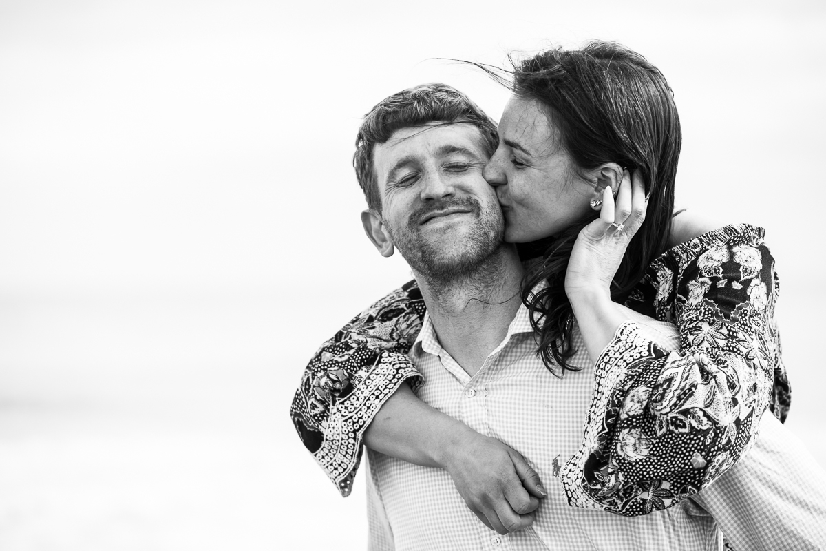 authentic wildwood nj proposal engagement photographers black and white image of cheek kiss