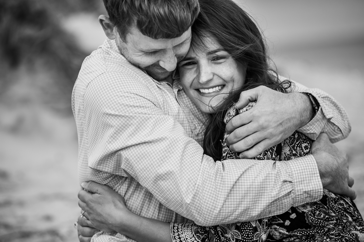 couple-embracing-each-other-during-engagement-session-photo