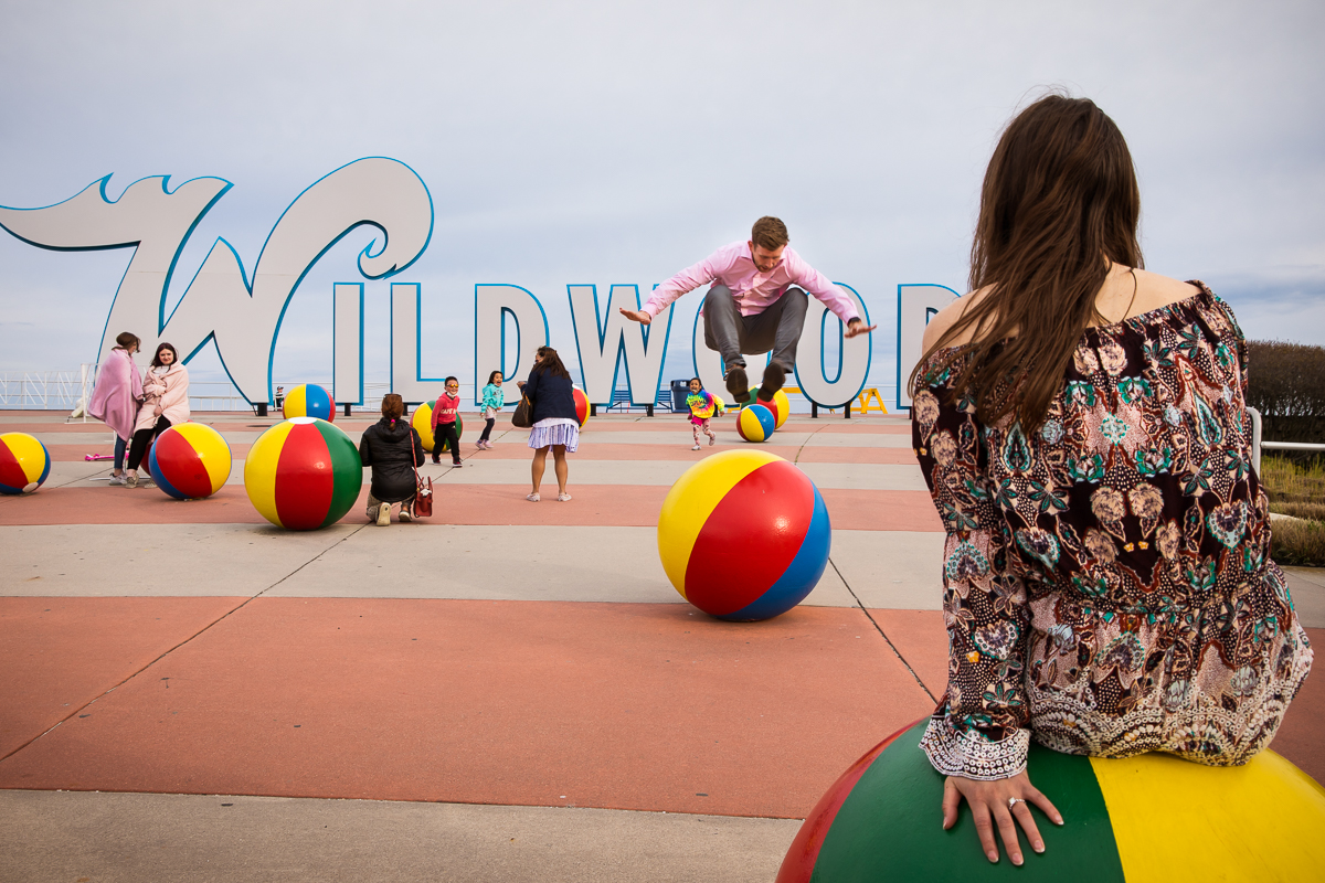 man-jumping-on-ball-statue-wildwoods-beach