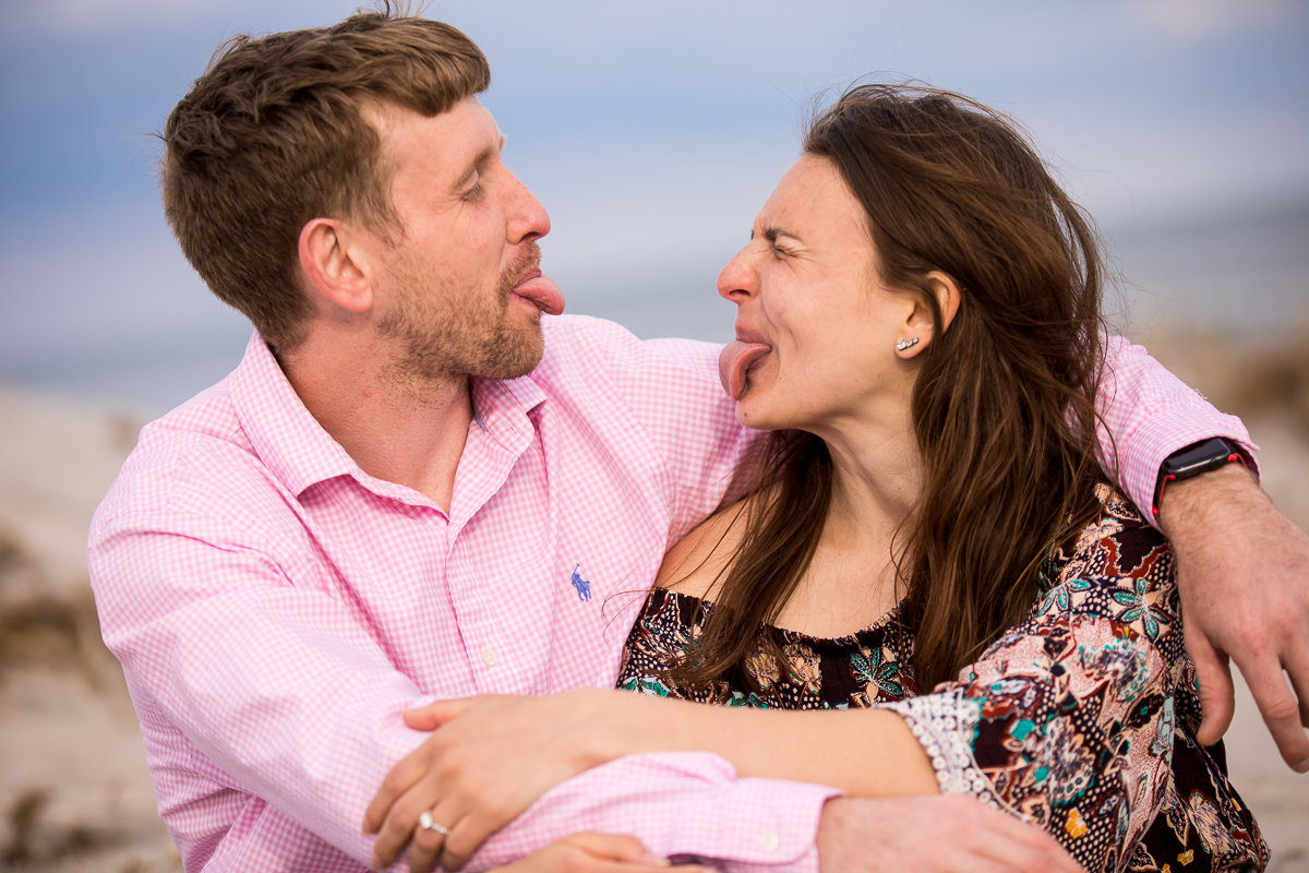 couple-sticking-tongues-out-at-each-other-engagement-photos
