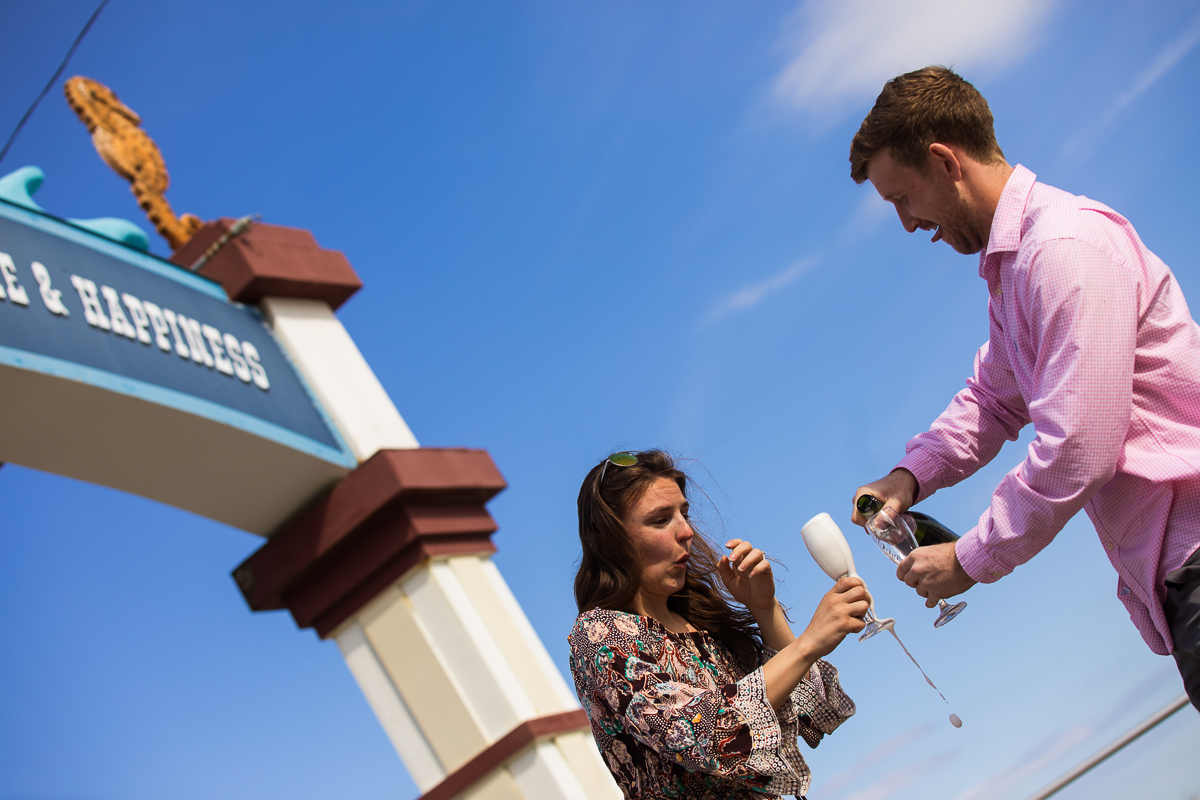 pouring-champagne-wildwood-beach-proposal