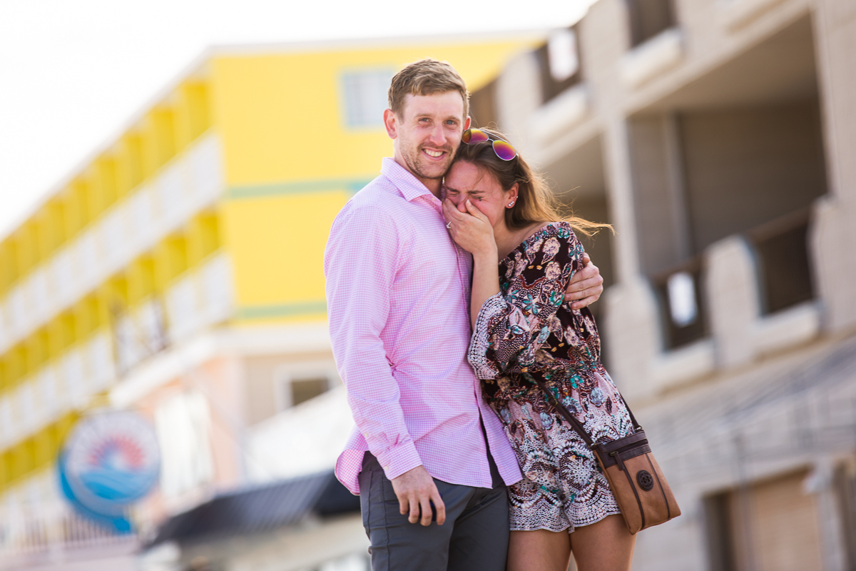woman-crying-surprised-emotional-after-proposal-on-boardwalk